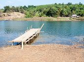 picture of pier a lake  - Old wooden pier near the tranquil lake in summer time - JPG
