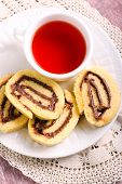 image of hazelnut  - Chocolate hazelnuts filling pinwheels and cup of tea - JPG