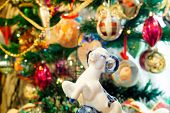 picture of ram  - White ceramic ram on background with Christmas decorations - JPG