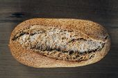 picture of whole-wheat  - Whole wheat bread on wooden background Close up shot - JPG