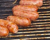 image of grilled sausage  - Barbecued meat and pork sausages on grill - JPG