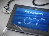 foto of paracetamol  - paracetamol word displayed on tablet with stethoscope over table - JPG