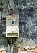 picture of fuse-box  - Cracked Painting Stone Wall With Rusty Fuse Box - JPG