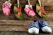 stock photo of shoes colorful  - Colorful toddler shoes on wooden background - JPG