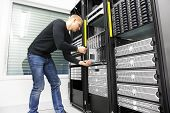 stock photo of racks  - It engineer or consultant working with installation of a blade server in data rack - JPG