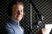 stock photo of recording studio  - Man In Recording Studio Talking Into Microphone - JPG