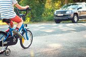 picture of traffic rules  - child on a bicycle at asphalt road - JPG
