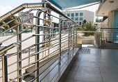 stock photo of step-ladder  - Stainless steel handrails are installed on the walls and steps - JPG