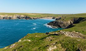 pic of polly  - Porth Joke beach next to Crantock bay Cornwall England UK near Newquay and on South West Coast Path also known as Polly Joke in spring with blue sea and sky - JPG