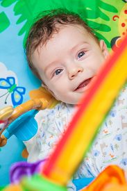picture of playmate  - 3 months old baby boy playing and learning on the playmat - JPG