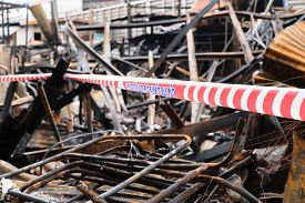 pic of no entry  - Fire damaged in summer house after blaze with Rope barrier no entry word - JPG