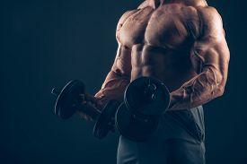 image of bicep  - Muscle man doing bicep curls - JPG