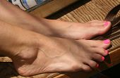 stock photo of painted toenails  - Closeup of a young woman - JPG
