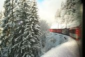 stock photo of engadine  - Riding on Swiss Train through the Engadine along Curve - JPG