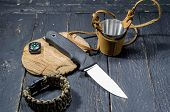The Sharpest Knife Of A Hunter. A Compass And A Metal Mug. poster