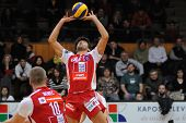 KAPOSVAR, HUNGARY - JANUARY 22: Guilherme posts the ball at a Middle European League volleyball game