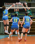 KAPOSVAR, HUNGARY - NOVEMBER 14: Rebeka Rak (L) strikes the ball at the Hungarian NB I. League woman