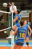 KAPOSVAR, HUNGARY - JANUARY 14: Barbara Balajcza (L) strikes the ball at the Hungarian NB I. League