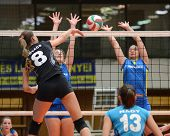 KAPOSVAR, HUNGARY - JANUARY 23: Barbara Balajcza (R) blocks the ball at the Hungarian NB I. League w