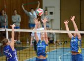 KAPOSVAR, HUNGARY - FEBRUARY 13: Rebeka Rak (C) blocks the ball at the Hungarian NB I. League woman
