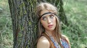 Close Up. Beautiful Young Hippie Woman Standing Near A Tree In The Forest poster