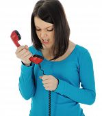 stock photo of bitchy  - The angry girl with a red handset - JPG