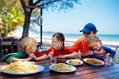 Family Vacation Lunch. Kids In Beach Restaurant poster