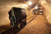 Underground train in mine, carts in gold, silver and copper mine.
