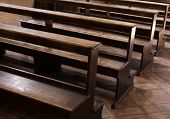 stock photo of pews  - Worn Church pews in a basilica in Italy - JPG