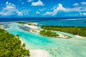 Rangiroa aerial drone video of atoll island motu and coral reef in French Polynesia, Tahiti. Amazing poster
