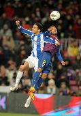 BARCELONA - FEB, 4: Liassine Cadamuro(L) of Real Sociedad vies with Dani Alves(R) of FC Barcelona du