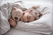 Little Cute Girl In Bed With Toy poster