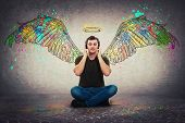 Music Gives You Colorful Wings. Relaxed Casual Guy Seated On The Floor Listening Favourite Music On  poster