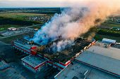 Heavy Smoke In Burning Industrial Warehouse Or Storehouse Industrial Hangar From Burned Roof, Aerial poster
