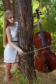 Professional Cellist Woman 20 Years Old With Cello Outdoors poster