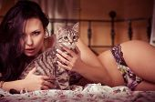 Sexy beautiful brunette girl in underclothes and cat