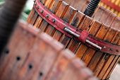 stock photo of wine-press  - Color detail of a wine manual grape crushing machine - JPG