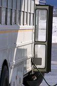 pic of high-octane  - white school bus pumping gas - JPG