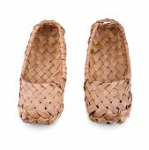 foto of bast  - Old Russian bast shoes isolated on white background - JPG