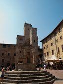 stock photo of cistern  - Cistern Square in San Giminiano Tuscany - JPG