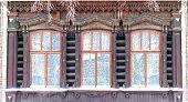 stock photo of siberia  - three old wooden curving tradition siberia windows - JPG