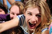 stock photo of groupies  - crowd of crazy teen girls celebrating a famous star on the red carpet - JPG