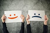 stock photo of emoticon  - Happy and sad face - JPG