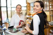 pic of cash  - Client at shop paying at cash register with saleswoman - JPG