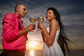 Portrait of bride and groom at sunset on sea