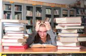 pic of midterm  - Teenager girl studying for her midterm in a library - JPG