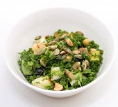 pic of kale  - Kale salad with pear pumpkin seed blueberry in white bowl on white background - JPG
