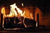 stock photo of cozy hearth  - Get warm and cozy by the fire - JPG