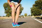 image of knee  - Female runner sport knee injury and pain - JPG