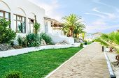 stock photo of hacienda  - Hacienda on a sandy beach facing Aegean sea in Thassos Greece - JPG